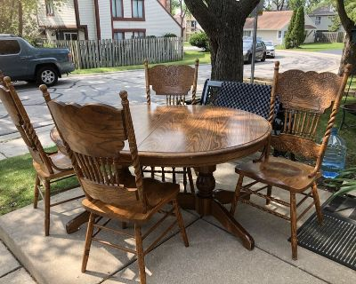 Dining room table and chairs, with three leaves