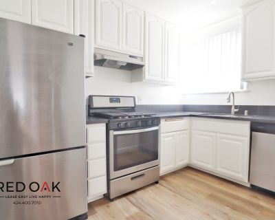 Large Completely Remodeled Corner Top floor Two Bedroom in Beverly Hills with Parking.