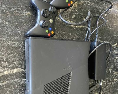 XBox 360, 2 controllers and 5 games.
