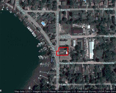 Condo Redevelopment Opportunity with Deeded Boat Slips on Lake Mary