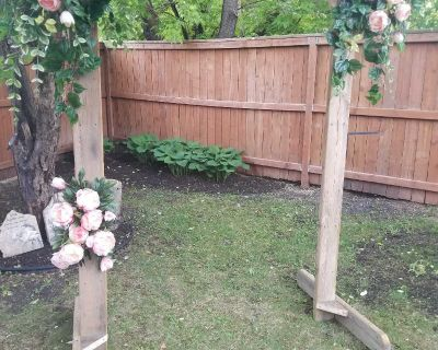 Wooden Arch with flowers and greenery