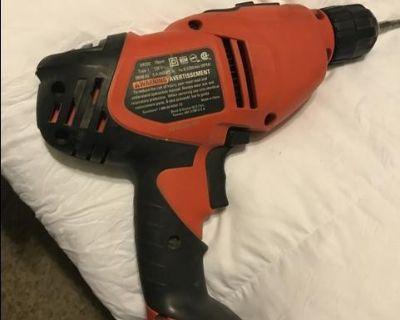 Corded power drills .