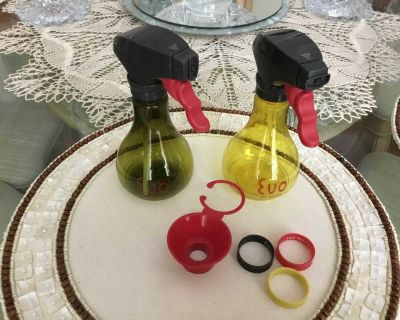 TWO EVO OIL SPRAY BOTTLES WITH FUNNEL &REVERSIBLE RUBBER BAND NAMES OF OILS