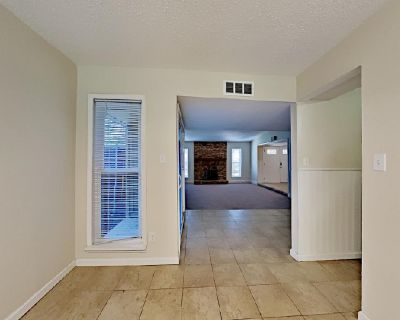 Tile and carpet flooring, and modern hardware are found throughout the interior!