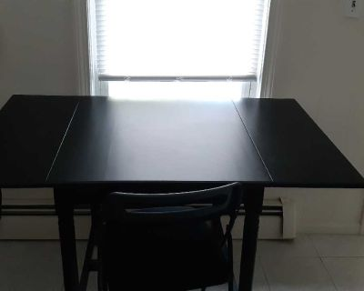 Black drop leaf kitchen table and folding chair