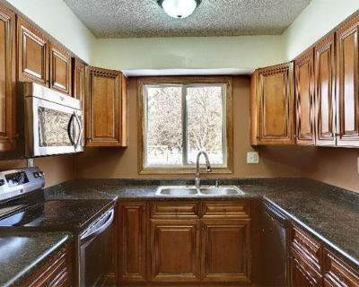 Give Your Kitchen Some Texture with Walnut Wood Cabinets