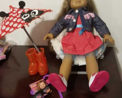 American girl doll with other doll accessories