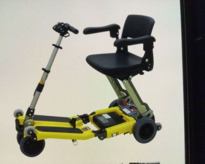 Lugged folding mobility travel scooter