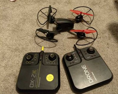 Sharper image drone with two remotes.