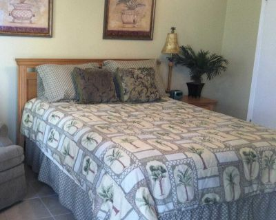 Palm Comforter, Queen/Full, with shams and bedskirt.
