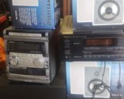 new audio system including speakers , sub woofer, anodized