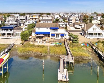 ENJOY BAY VIEWS!! Bayfront home, shady front porch 2 boat docking areas, gameroom to watch TV, A short bike ride or walk to Avalon's fine business district for ice cream, dining, mini golf, shopping and more. - Avalon