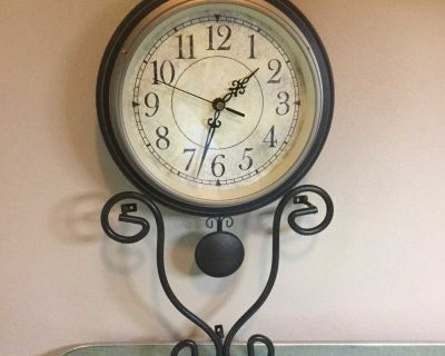 Wall clock with moving pendulum