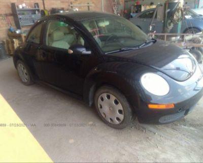 Salvage Black 2010 Volkswagen New Beetle Coupe