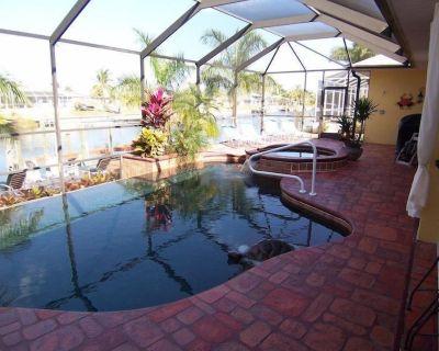 Villa Cecilia 1501 SW Cape Coral 3b 2ba home electric heated pool/spa gulf access canal Boat Dock - Pelican
