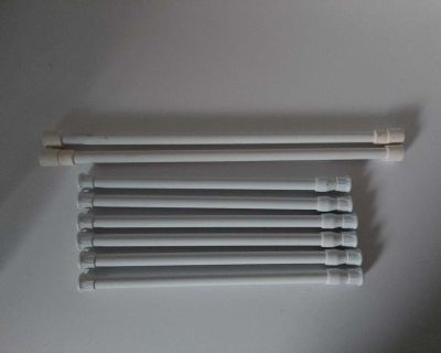 Set of 8 Camco Spring Loaded Tension Bars, holds everything in your fridge or cabinets from shifting