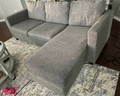 Sectional sofa Grey in colour