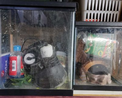 2 aquariums with heat lamps , covers, water bowl , chemical for reptiles