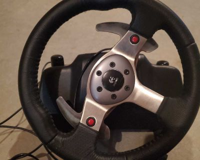 Logitech G25 racing wheel with pedals and shifter