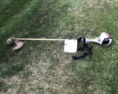 STIHL FS55RC STARIGHT SHAFT WEED EATER IN GRETA CONDITION WITH MANUAL.