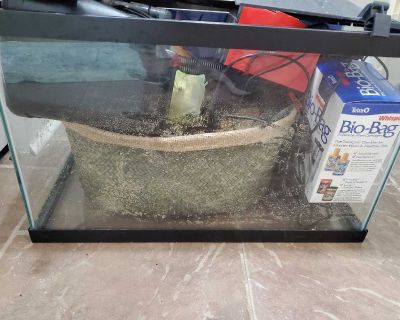 Fish tank with working pump and accessories.