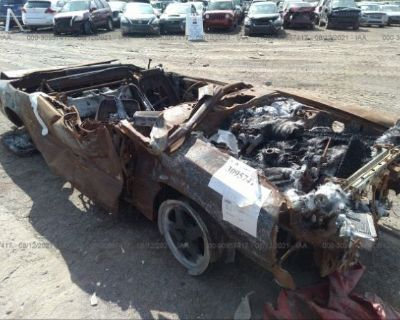Salvage Brown 1990 Ford Mustang