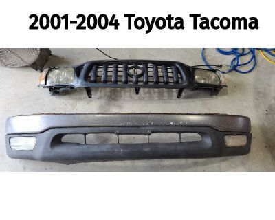 2001-2004 Toyota Tacoma Front Bumper Grille Headlights