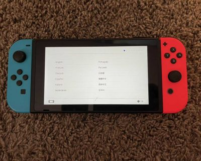 Nintendo switch with 2 joycon sets, 2 wireless controllers and 3 games