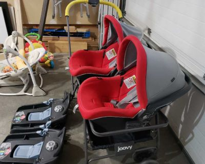 Free Twin stroller with car seat base.
