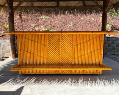 Bamboo Tiki bar with storage cabinets, outdoor patio and deck dining table