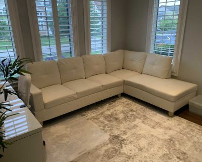 Like New - Leather Sectional Sofa With Storage Ottoman