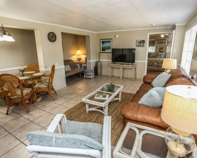 Welcome to 269 Driftwood Lane - Unit #1 nestled within a quiet residential section at the desirable southern end of the island. - South Island