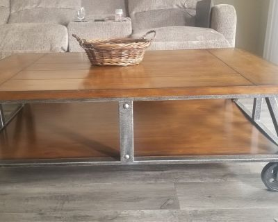 Modern unique cast iron wood coffee table with 4 iron pulley clogs.