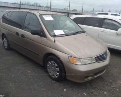 Salvage Tan 2000 Honda Odyssey