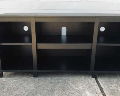 Tv stand with cubby holes for storage.