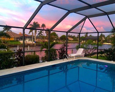 4 bedrooms (2 MASTER) 3 bathrooms, south facing, salt water pool boat dock golf access - Pelican