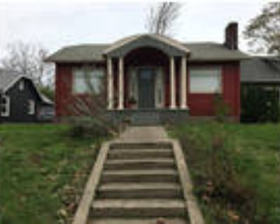 Charming Arbor Lodge Bungalow with refinished wood floors and newer windows!!