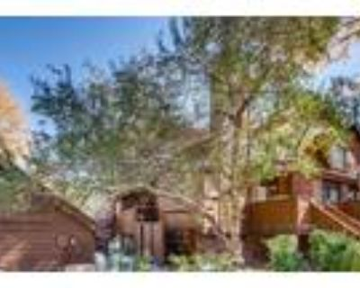 Quaint townhome backs to pond in the highly sought after community of Sequoia.