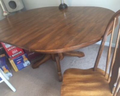Beautiful all-wooden table and 6 chairs with leaf-$200.00