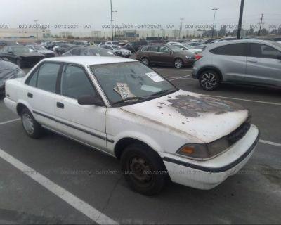 Salvage White 1989 Toyota Corolla
