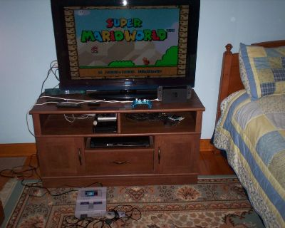 super nintendo and two controllers and hookups and super marioworld game - tv is not included