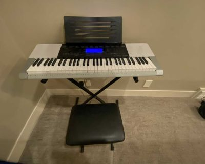 Casio keyboard piano with stand and bench