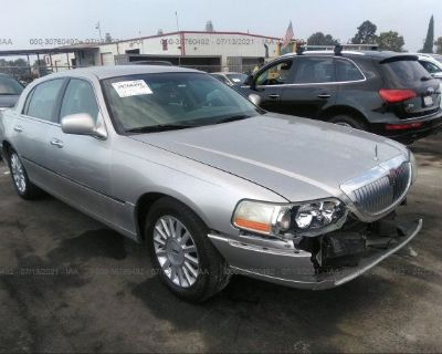 Salvage Silver 2004 Lincoln Town Car