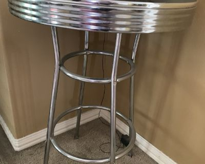 Metal and black bar height table for game room or media