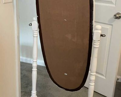 Oval mirror on stand