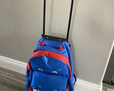 Rolling backpack suitcase (blue hippo)