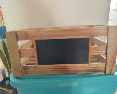 Wooden crate with chalkboard
