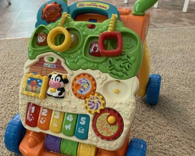 push toy , activity table , and walker