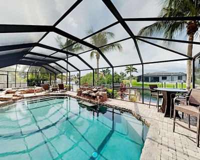 Manatee Oasis   Canal-Front Dock   Screened Lanai with Designer Pool, Hot Tub - Pelican