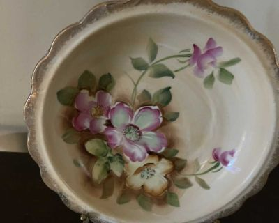 Decorative wash bowl with stand and matching pitcher.